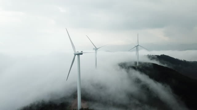 sea of clouds flowing over wind power plant at guinemi village / taebaek-si, gangwon-do, south korea - mountain peak stock videos & royalty-free footage