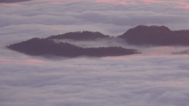 sea of clouds in the mountains at break of day. - satoyama scenery stock videos & royalty-free footage