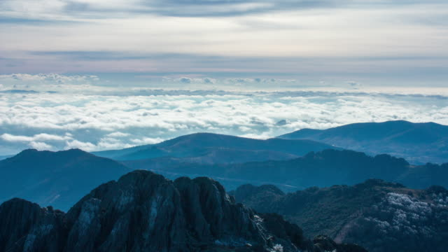 Sea of clouds on a mountain landscape. Timelapse