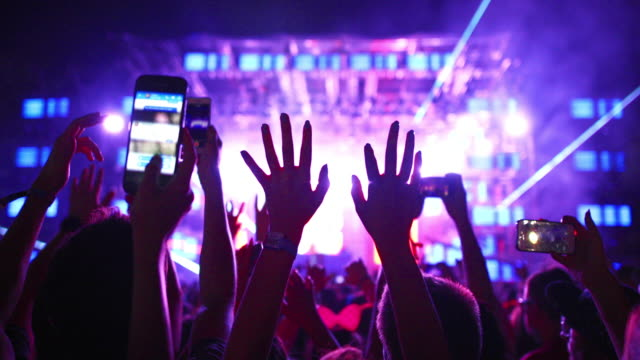 sea of hands at a concert party. - popular music concert stock videos & royalty-free footage