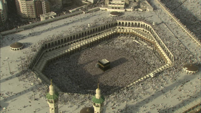 A sea of Islamic pilgrims gather around the Kaaba in Mecca.