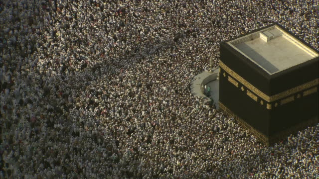 A sea of Islamic pilgrims surge around the Kaaba in Mecca.