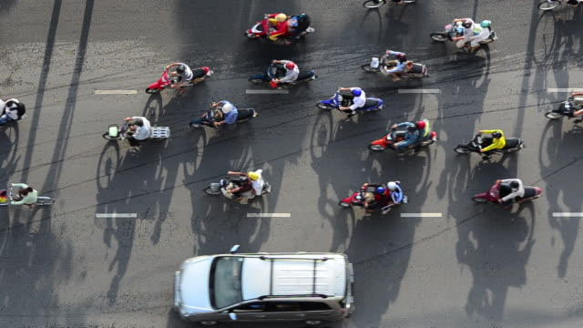 ms sea of mopeds during rush hour in central saigon / ho chi minh city, saigon, viet nam - vietnam meridionale video stock e b–roll