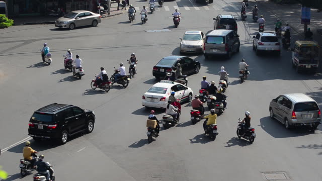 A sea of mopeds during rush hour in central Saigon, Ho Chi Minh, Vietnam, Asia