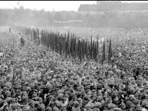 stockvideo's en b-roll-footage met / sea of people column of flag bearers moving through / trotsky with woman visiting ruins with other people - communisme