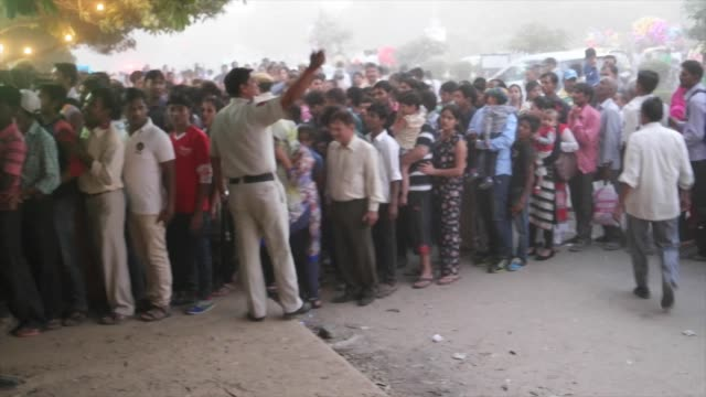 sea of people lined up at the entrance for security checks to the last day of dusshera celebrations in delhi ncr vijayadashami also known as dussehra... - dashahara stock-videos und b-roll-filmmaterial