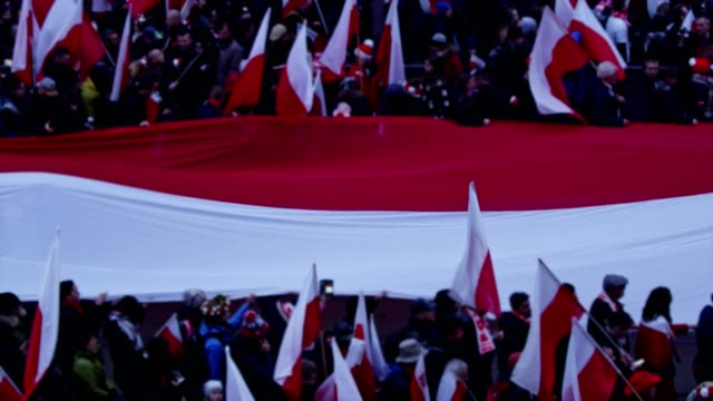sea of polish flags on independence day march - marching stock videos and b-roll footage