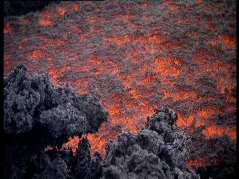 stockvideo's en b-roll-footage met sea of red and black molten lava flows slowly down mount etna volcanic rocks in foreground - 1992