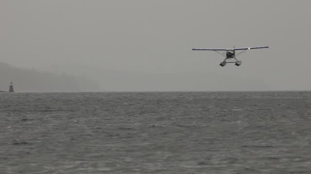 sea plane landing hd - floating moored platform stock videos & royalty-free footage