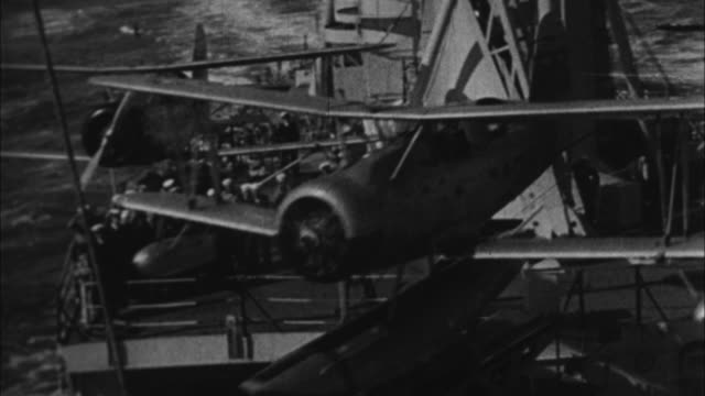 vídeos de stock, filmes e b-roll de us sea planes being launched from ship / united states - 1941