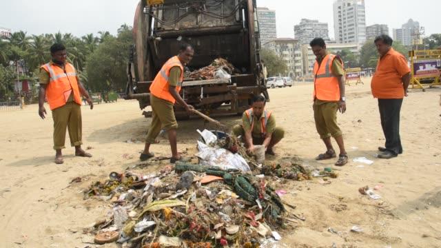 sea pollution after immersion of hindu god ganesha, mumbai, india. - rubbish stock videos & royalty-free footage