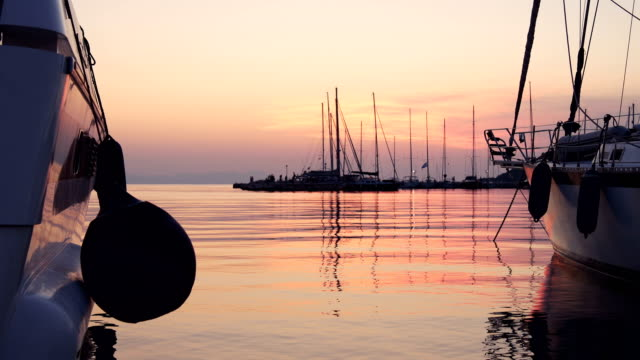 sea port with yachts in sunset - anchored stock videos & royalty-free footage