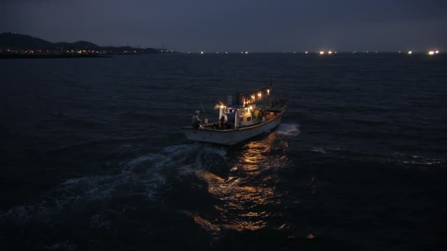 sea scenery of the fishing boat in jeju island - small boat stock videos & royalty-free footage