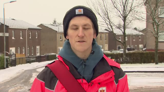 sea shanty tik tok channel goes viral; scotland: airdrie: ext various of postman nathan evans taking post from mail box and away on snowy street... - postal worker stock videos & royalty-free footage
