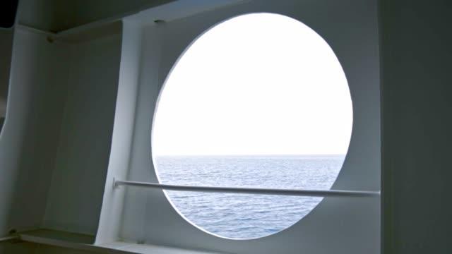 vídeos y material grabado en eventos de stock de cámara lenta del mar en el ojo de buey de los cruceros - barco de pasajeros