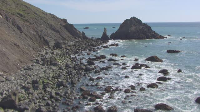 ws aerial pov sea stack and coastline at lost coast, california - rocky coastline stock videos & royalty-free footage
