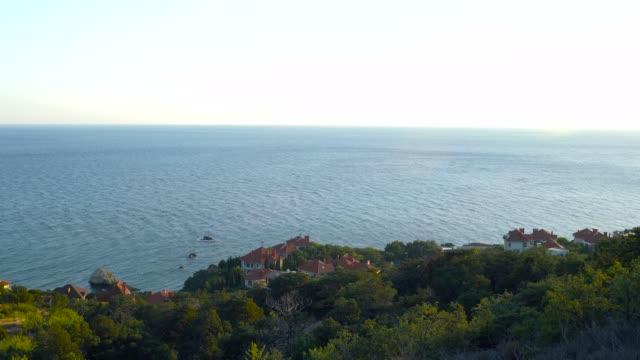 sea, sun and mountains. beach town. - sea robin stock videos & royalty-free footage