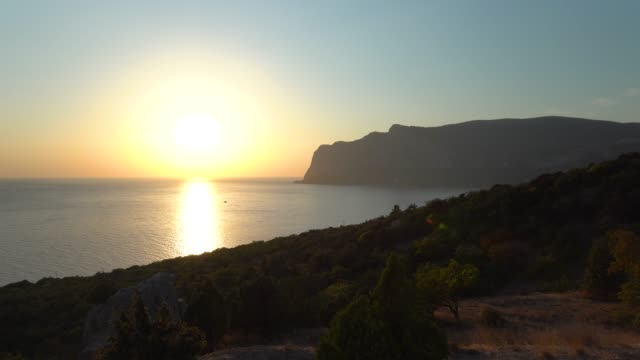 sea, sun and mountains. sunset. - sea robin stock videos & royalty-free footage