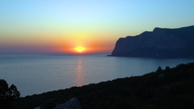 sea, sun and mountains. timelapse + real time. - sea robin stock videos & royalty-free footage