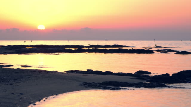 sea sunset. peaceful scenery - wet stock videos & royalty-free footage