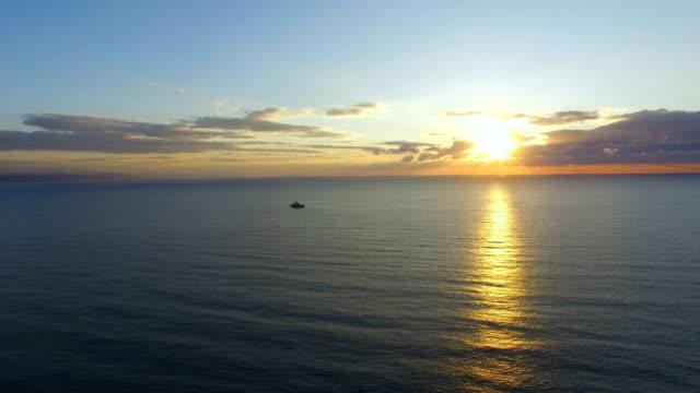AERIAL: Sea surface on sunrise