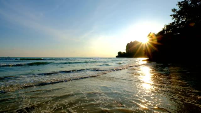 sea tide in sunset light at railay beach, krabi, thailand - railay beach stock videos and b-roll footage