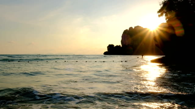 Sea tide in sunset light at Railay beach, Krabi, Thailand