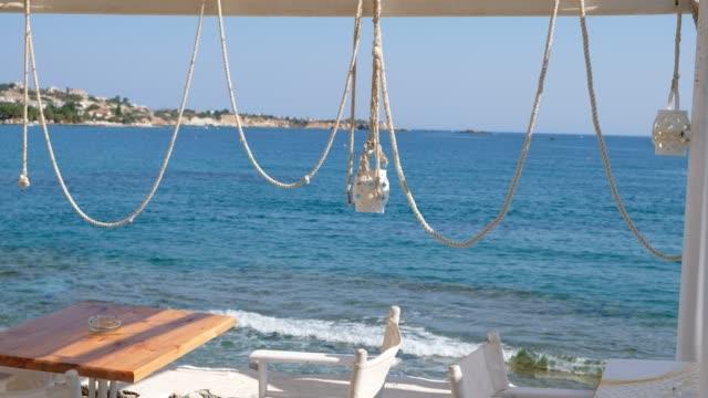 sea view from a mediterranean cafe, restaurant, bar by the sea, tavern on the aegean - 席点の映像素材/bロール