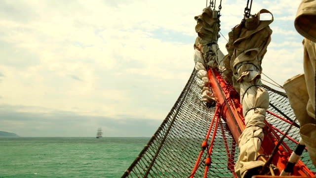 sea view from the bowsprit of an old sailing ship