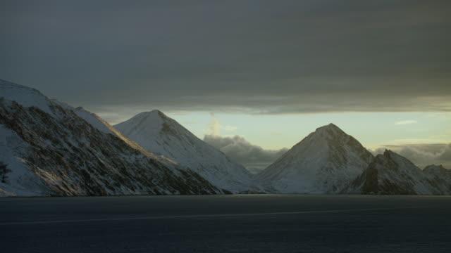 Sea View Of Snowy Mountain Peaks
