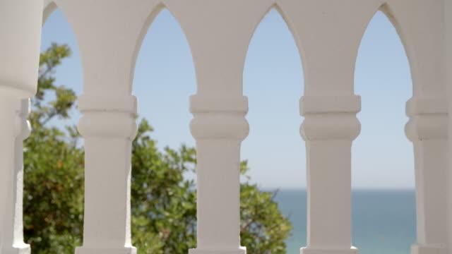 sea view through white arches / algarve - algarve stock videos & royalty-free footage