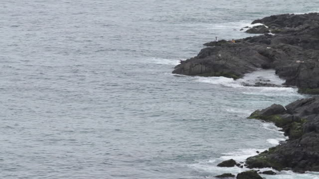 sea water hit rocks with waves - hitting stock videos & royalty-free footage