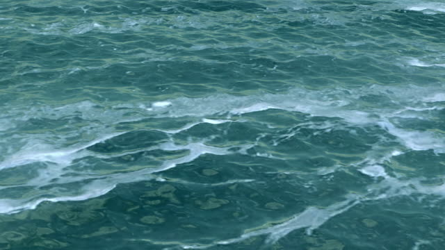 Sea water surface with foam