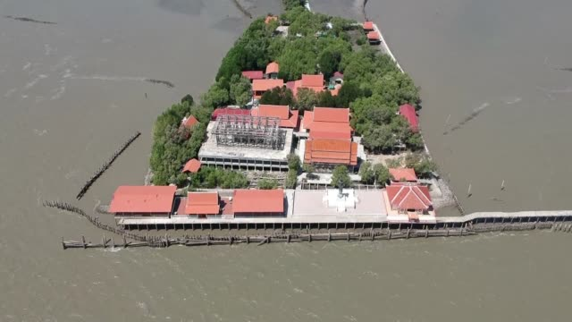 stockvideo's en b-roll-footage met sea waters have surrounded his temple and his neighbours have fled inland but thai abbot somnuek atipanyo is refusing to move a stubborn symbol in... - coastal feature