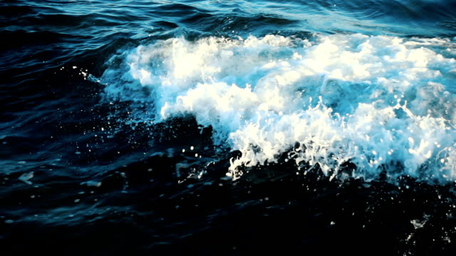 sea waves crashing on stone - breaking stock videos & royalty-free footage
