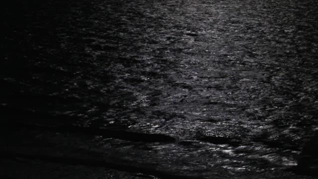 sea waves illuminated by full moon - 4k stock videos & royalty-free footage