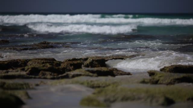 Sea waves roll over the stones. Low angle view. Kangaroo Island, South Australia.