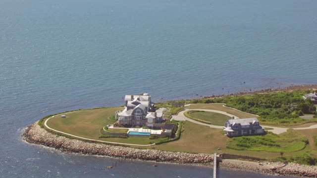 ws zo aerial pov sea with mansion near coastline / new bedford, massachusetts, united states  - new bedford stock videos & royalty-free footage