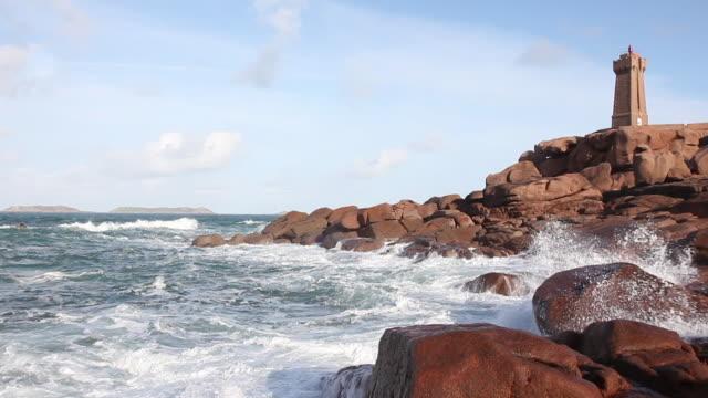 vidéos et rushes de sea with rocks and a lighthouse - littoral