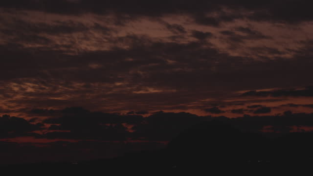 sea with sanbangsan mountain at sunset / jeju-do, south korea - romantic sky stock videos & royalty-free footage