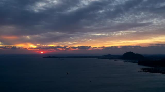 sea with songaksan mountain and sanbangsan mountain at sunset / jeju-do, south korea - romantic sky stock videos & royalty-free footage