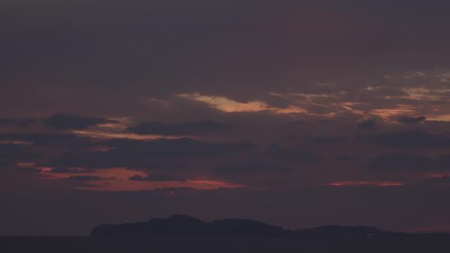 sea with songaksan mountain at sunset / jeju-do, south korea - romantic sky stock videos & royalty-free footage