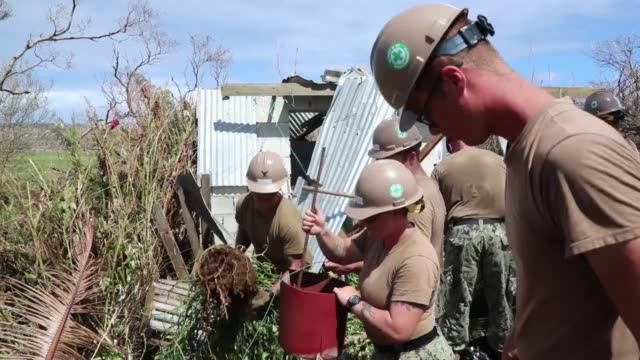vídeos y material grabado en eventos de stock de seabees with naval mobile construction battalion 1 build temporary shelters for victims of super typhoon yutu on the northern mariana islands... - tinian