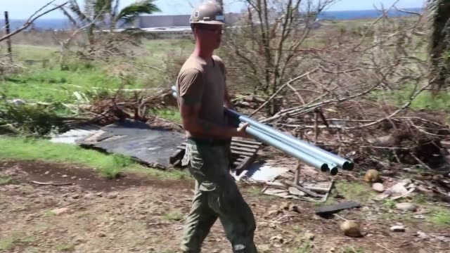 seabees with naval mobile construction battalion 1 build temporary shelters for victims of super typhoon yutu on the northern mariana islands.... - temporary stock videos & royalty-free footage