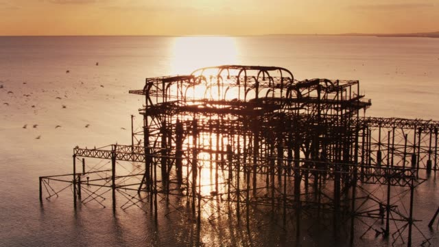 seabirds flying around ruined west pier, brighton - drone shot - 1975 stock videos & royalty-free footage