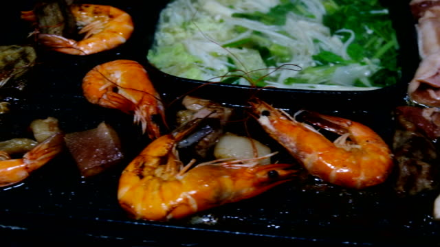 seafood and pork cooking on hot pan