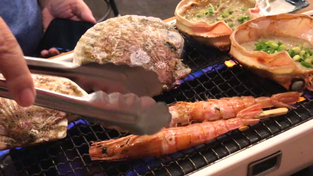 seafood grilled in dinner times , tokyo , japan - seafood stock videos & royalty-free footage