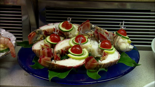 cu seafood on plate at dallmayr, luxury delicatessen, munich, bavaria, germany - 陳列ケース点の映像素材/bロール