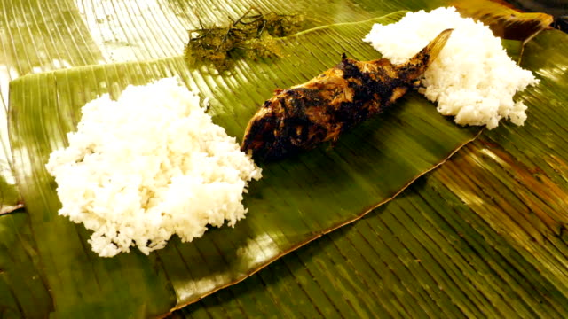 seafood plate served in a banana leaf in a restaurant - filippine video stock e b–roll