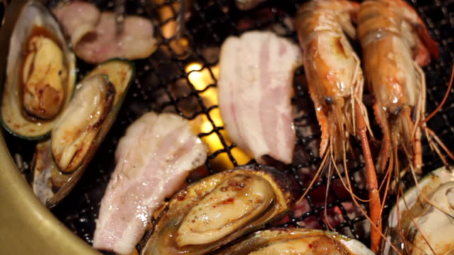 bbq seafood pork on the barbecue grill - prawn stock videos & royalty-free footage